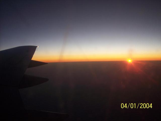 slnko z lietadla, západ...